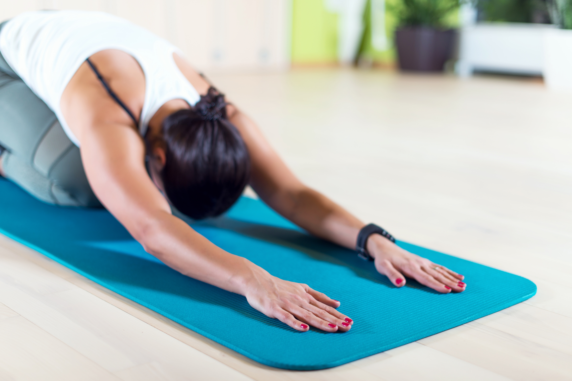 a woman practicing yoga physical therapy