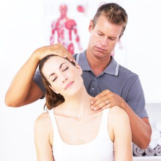 Man stretching a woman's neck
